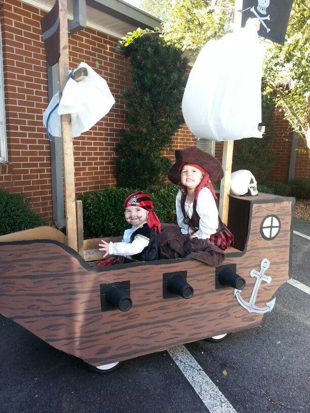 Pirate ship made with cardboard and using kids wagon.