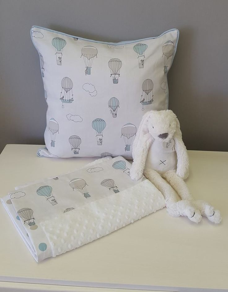 Reversible scatter cushion fashioning our Up and Away, Blue fabric; which is printed especially, and exclusively, for Studio Collection and an adorable blanket and soft toy to wrap it all up.