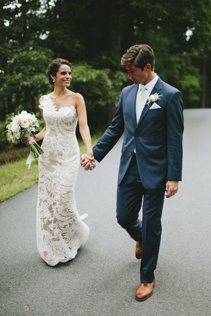The lace work on this one shoulder wedding dress is simply amazing. Would you wear this down the aisle? Photographer: Lime Green Photography via Wedding Party