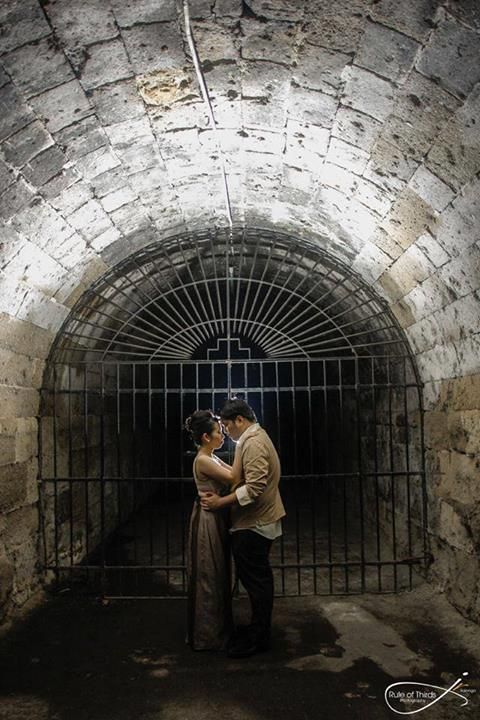 Classy and dramatic in the underground. This was actually shot in Old Manila: Fort Santiago, Intramuros. #victorian #prenup #wedding #kasal #photography #weddingplanner #oldmanila #manila #intramuros #pictoral   Set up by Monina E Events and Marketing. [www.kasal.com]