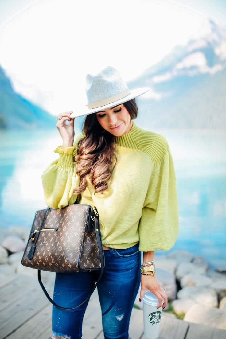 SEPTEMBER 5, 2017 BRIGHT COLORED PRE-FALL FASHION - OUTFIT DETAILS: SWEATER: Free People | DENIM: AG Jeans | SLIDES: Steve Madden | BELT: Gucci | HAT: Lack of Color | EARRINGS: The Styled Collection | HANDBAG: Louis Vuitton [Poppincourt MM] | BRACELET: The Styled Collection | WATCH: Nixon | LIPS: Kim KW + Charm |
