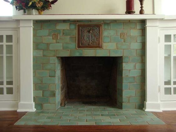 Practical and artistic, tile is preferred for new fireplaces. Before 1915, fireplace surrounds in both builders' bungalows and fine Craftsman homes likely were done in brick. What we think of as Arts & Crafts tile really dates to the 1920s, including, for example, the work of Ernest Batchelder and tiles produced by Malibu Potteries …