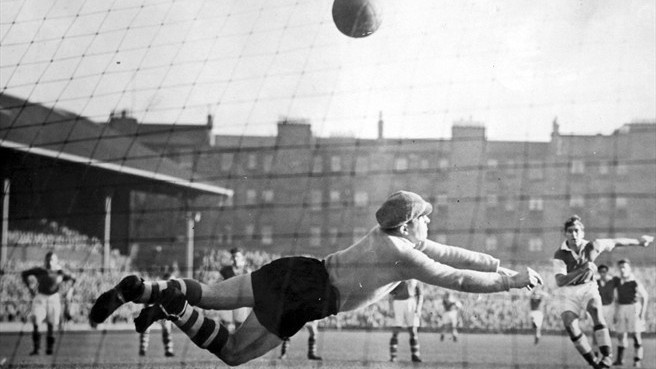 Eddie Turnbull (right), one of Hibernian's Famous Five, scores against Hearts in a post-war Edinburgh derby