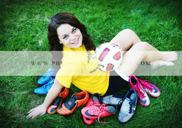 Soccer senior picture. only id do it with volleyball or softball stuff :)