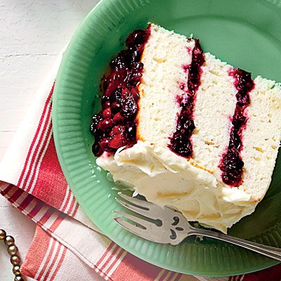 White Cake with Cranberry Filling and Orange Buttercream | This cake will be the star of your holiday meal. Your guests will be begging for the recipe.
