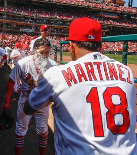 St. Louis Cardinals Team Photos - ESPN St. Louis Cardinals' Randal Grichuk, left, gets a faceful of water from teammate Carlos Martinez after hitting a two-run home run in the third inning of a baseball game against the Milwaukee Brewers, Thursday, April 14, 2016 in St. Louis. (AP Photo/Tom Gannam)