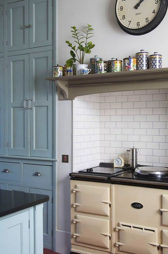 Simplified Victorian kitchen. Like the stove tucked in to an alcove that looks suspiciously like an old fireplace.