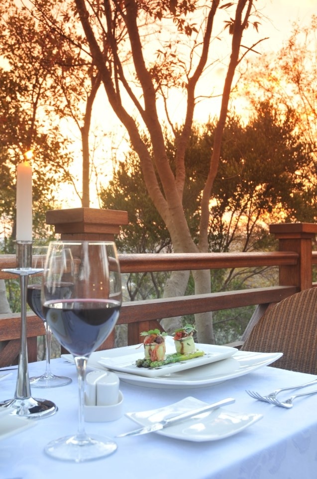 Escape in the sunset with a glass of red wine