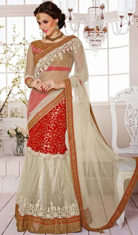 Classic buttercream and red banarasi silk, jacquard, net, satin lehenga sari is perfect for festive season party. The sari is beautified with woven lace, silk thread embroidered border, crystal stones, self woven design like jaal work and dangler which makes you center of attraction of everybody's eyes. The sari comes with matching stitched blouse as shown in the picture. #PartyWearLehengaSareeDesign