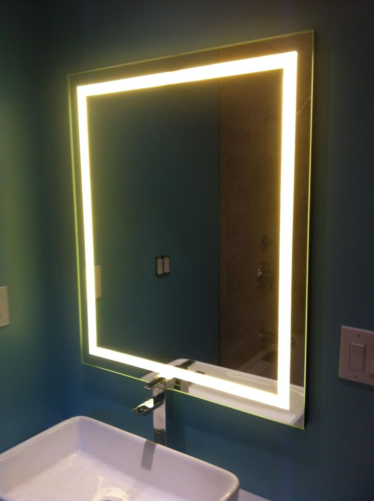 Great blog post with step by step instructions to DIY this LED Backlit Mirror - Imgur. $150 hard cost and what seems like a lot of work to me, but looks great.