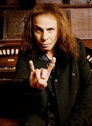 """Possibly the greatest singer in metal history, Ronnie James Dio was born Ronald James Padavona in 1942. The immortal vocalist first put the """"Dio"""" moniker, which means """"God"""" in Italian, on the 1961 release of Ronnie Dio and  the Prophets' second album.    However, Ronnie was inspired to acquire the pseudonym from mobster Giovanni Ignazio Dioguardi, who went by the name of Johnny Dio. The singer used his legendary name in Rainbow, Elf, Black Sabbath, Dio and Heaven & Hell until his tragic…"""