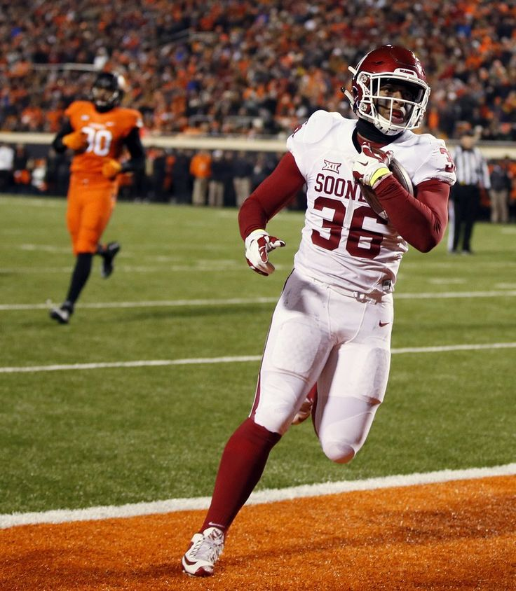 Oklahoma's Dimitri Flowers (36) scores a touchdown in the second quarter during the Bedlam college football game between the Oklahoma State Cowboys (OSU) and the University of Oklahoma Sooners (OU) at Boone Pickens Stadium in Stillwater, Okla., Saturday, Nov. 28, 2015. Photo by Nate Billings, The Oklahoman