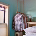 DIY shirt hanging- right over the radiator, too, so I can hang damp shirts and they'll dry quickly!