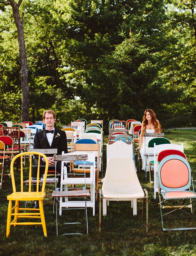 bride and groom with mixed chairs // event design by Glitter + Rye // chairs from vintage sources and Rent Patina