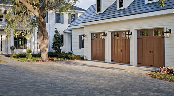 Three Charming Wood Garage Doors With Dark Hardware Right
