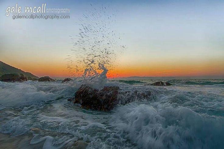 Splashing water at Smitswinkel bay early morning. .