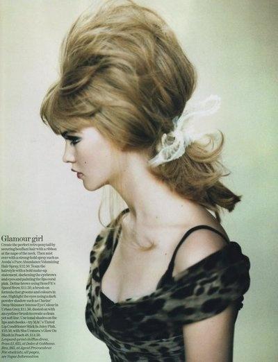 60's...ya gotta love the hairdo's of that era...remember them fondly..