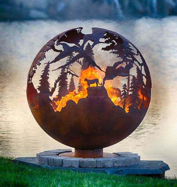 A Big Horned Sheep, Bear and Cougar or Mountain Lion are featured in the craggy high mountain ridges of this mountain fire pit sphere.
