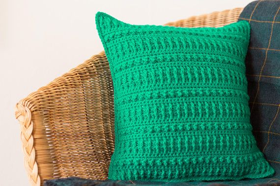 This accent cushion cover is certainly bold and bright in an almost neon shade of jade green. Gorgeous when paired with greys or other colourful and funky pillows, this green cushion definitely adds a pop of colour to a room.   DETAILS AND FEATURES  - Created using a textured crochet