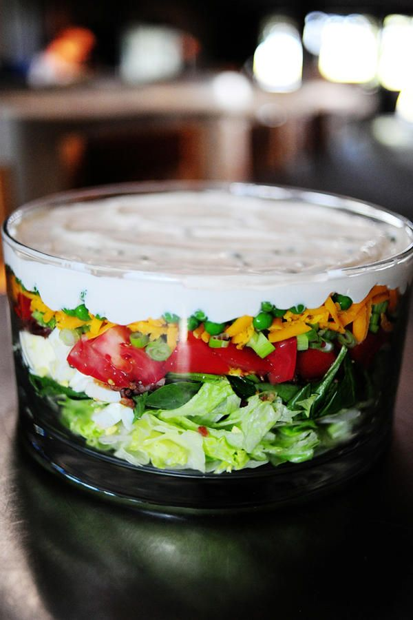 The Pioneer Woman's Layered Salad - 7-Layer Salads Every Southern Hostess Needs - Southernliving. The Pioneer Woman adds an extra dose of nutrition to her take on the classic 7-layer salad with the addition of spinach. Fresh dill is added to the dressing, giving the mayo and sour cream mixture a light and fresh flavor.  Get the recipe here.