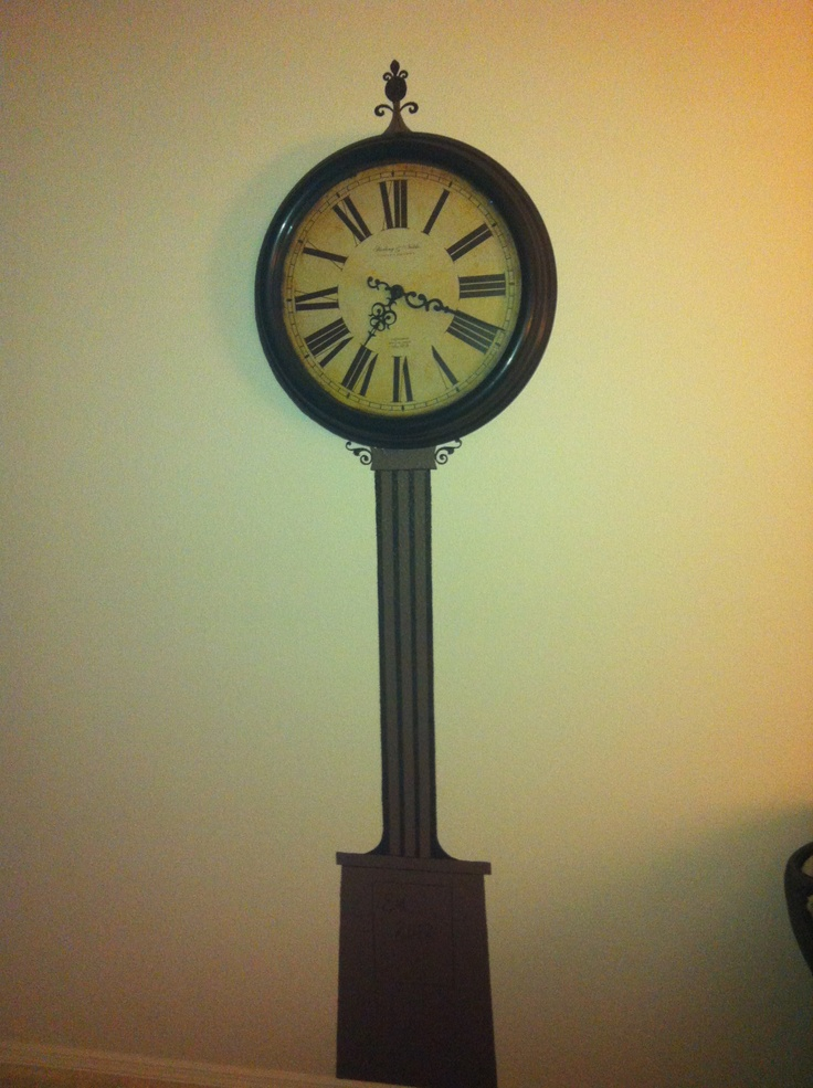 Like old clock towers? Don't spend a fortune! Paint the 'base' on the wall and hang your big clock!