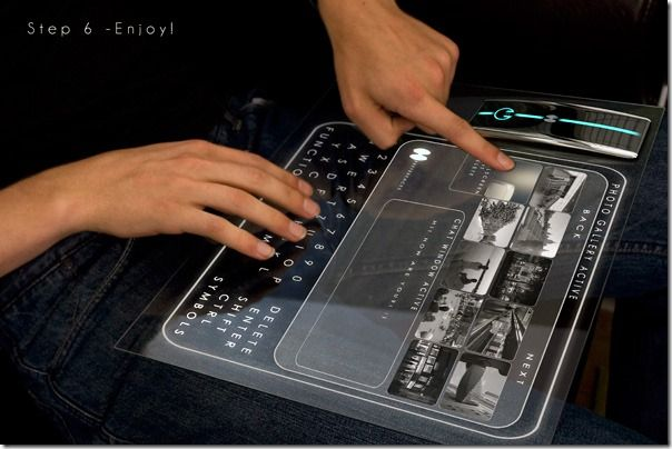 This unusual concept computer-of-the-future allows the user to operate the device there, where you can find a glass surface. The user simply attaches the central unit to any glass surface like a window or coffee table, switches on the power, and watches their system light up before their eyes. The display appears as an interactive hologram on the glass that the user merely has to touch to operate. It also makes for an easy, take-anywhere way to project photos and presentations or stream movies.