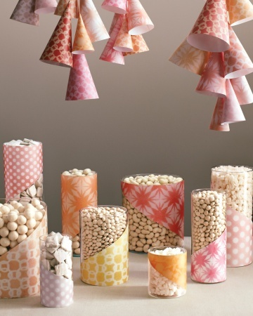 Invite guests to a festive candy buffet adorned with lacy lanterns and candy jars