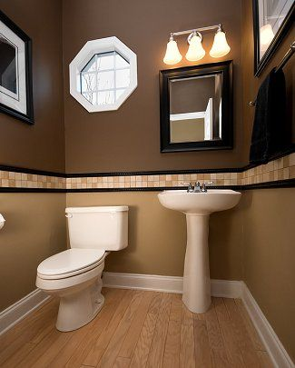 These 2 colors compliment eachother nicely brown and tan for Small toilet room design