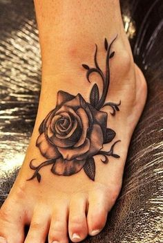 black rose foot tattoo