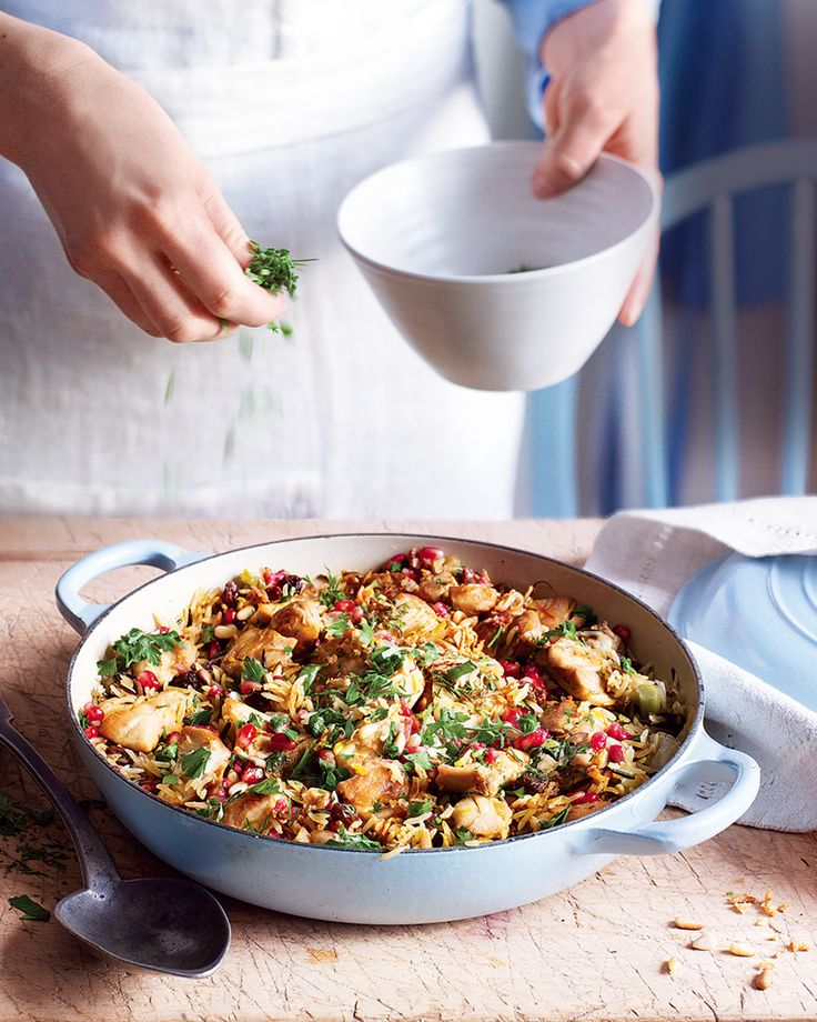 The key to a perfect Persian pilaf is cooking the rice until it's lightly spiced and fluffy then adding fresh herbs, pomegranate, raisins and chicken. Don't forget the crust on the bottom – that's the best bit!