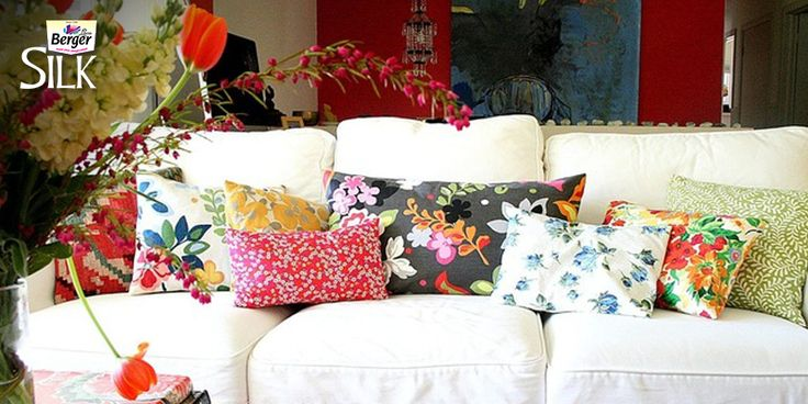 If you have a white sofa in your living room and you want it to pour in some brightness, use colorful cushions on it!
