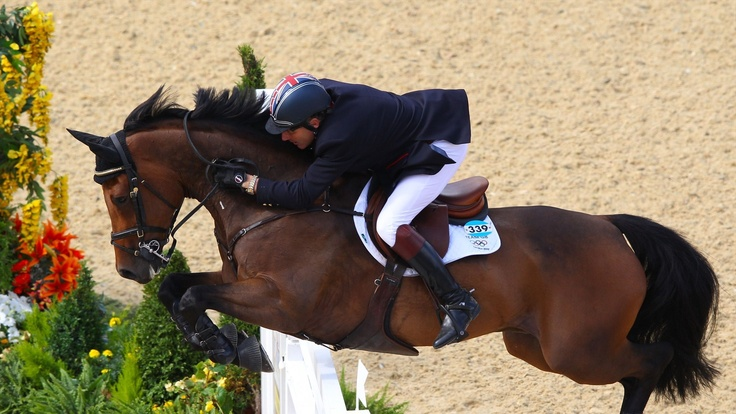 Peter Charles of Great Britain riding Vindicat helps to secure the gold for Team GB in the Team Jumping competition.