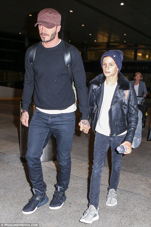 Back home: On Sunday, David was seen with 13-year-old son Romeo as they arrived in Los Angeles
