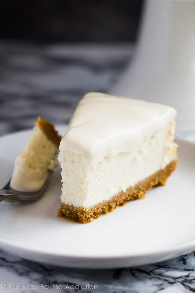 Deliciously creamy vanilla cheesecake on top of a cinnamon spiced digestive biscuit crumb crust and topped with a sour cream topping!