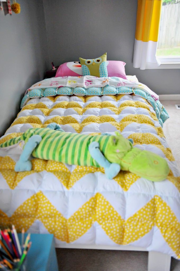"""Twin size puff quilt.  I have been hoarding my kids' baby clothes and extra blankies to make them each a personalized quilt.  I like this design -- looks so cozy and warm with all of those puffed-up squares or """"biscuits."""""""