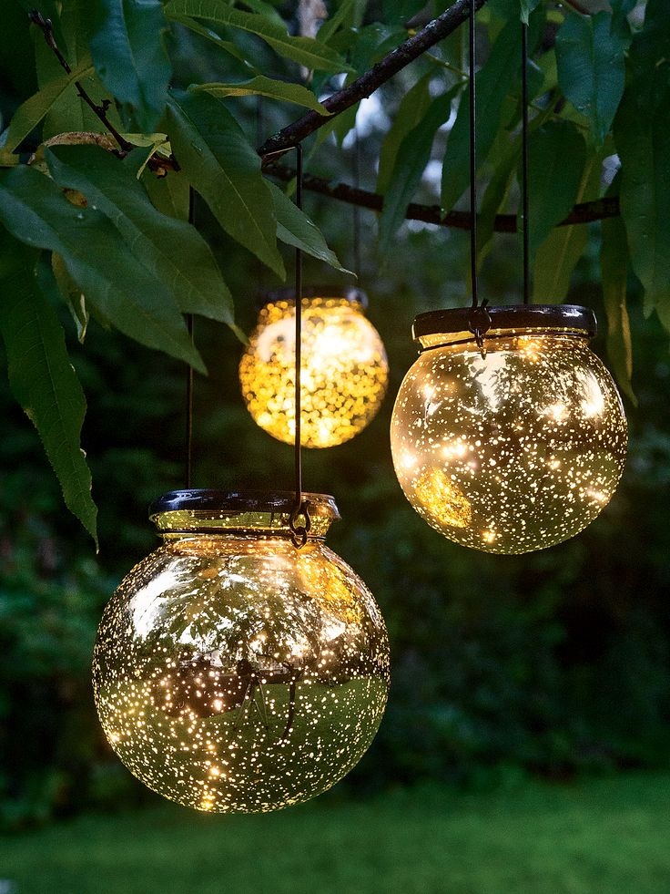 LED Fairy Dust Balls. Add a magical touch to porch or landscape. Battery-powered, so you can hang them in the shade.  Built-in timer; set it once and it turns on at the same time each day. Large is 6 inches in diameter; medium is 5 inches in diameter.