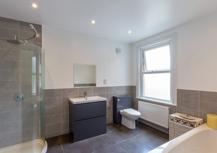 Large Modern Bathroom Renovation | London Terrace Property | Frosted Window  | Large Curved Shower |