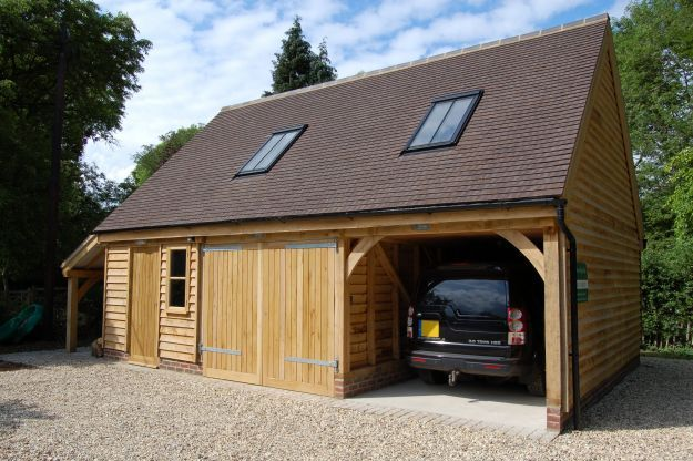Two bay garage with log store & accommodation above. Andrew Page Oak Ltd, South Oxfordshire. Quality Oak framed Garages, Garden Rooms, Gazebos, and Orangeries in Green Oak. Bespoke furniture and joinery.