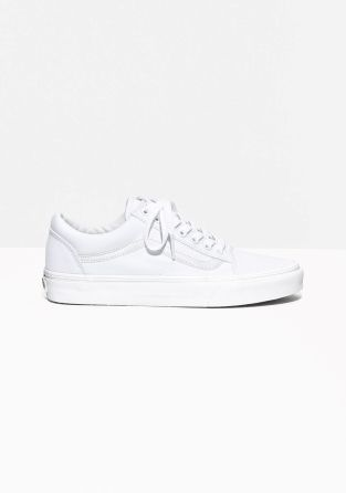 VANS Lace-up textile sneakers in a classic white hue. These 'old school'- influenced shoes have the brand-logo attached on the back of the heel.