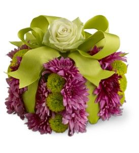 """A Gift For You:  Here's a charming gift that's fun, bright and just right for anyone who's celebrating a birthday, or any occasion that might benefit from a gift box made of bright blossoms! Perfect for office birthdays, or as a """"thinking of you"""" present.    A pave arrangement of fresh flowers in shades of purple and green is designed in the shape of a gift box, then decorated with a green satin ribbon and a rose. www.tilliesflowers.com"""
