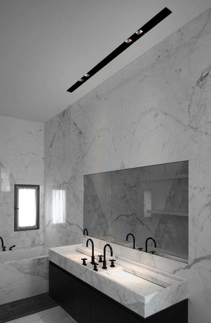 Beautiful marble bathroom with profile LED lighting