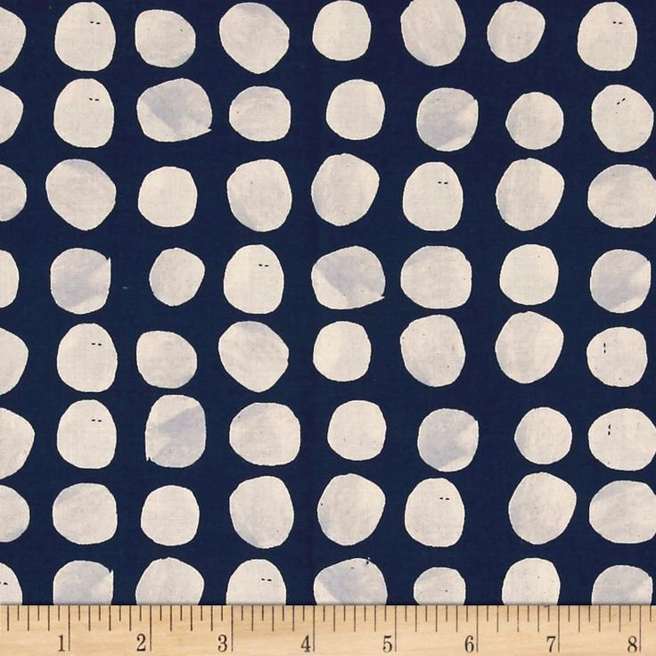 Sienna Pebbles Indigo. Designed by Alexia Marcelle Abegg. This cotton print collection features desert inspired designs with soft edges and a homey feel. Muted colors and a hand-stamped appearance. This design is printed on an unbleached cotton base, which will include small natural variations and spots. Colours include navy, cream, and grey.
