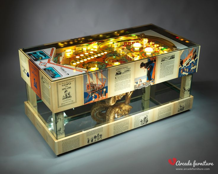 """This complex outstanding piece from the Arcade Furniture is made from the original renewed playfield of the Sinbad pinball built by Gottlieb in 1978. The outer decoration featuring original, clear coated pages from """"The Seven Voyages of Sinbad"""" from 1926. For further information visit our website: www.arcadefurniture.com or FB page http://www.facebook.com/pages/Arcade-Furniture/208886032582245"""