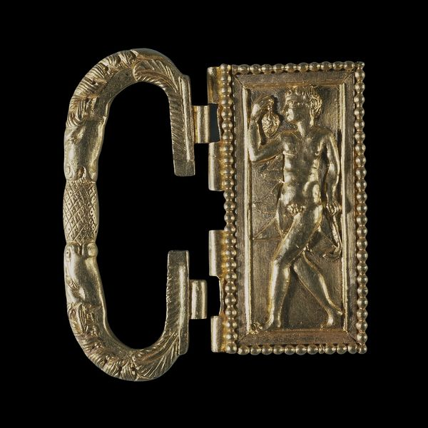 Gold buckle from the Thetford treasure Roman Britain, 4th cent AD This gold belt buckle is part of a remarkable hoard of late-Roman gold jewellery and silver tableware found near Thetford, Norfolk, in 1979. The figure on the plate is a dancing satyr holding a bunch of grapes. Two horses' heads form the loop or bow. The buckle is one of a number of items in the treasure, which was buried around AD 390, by which time the Roman Empire was officially Christian. Source: British Museum