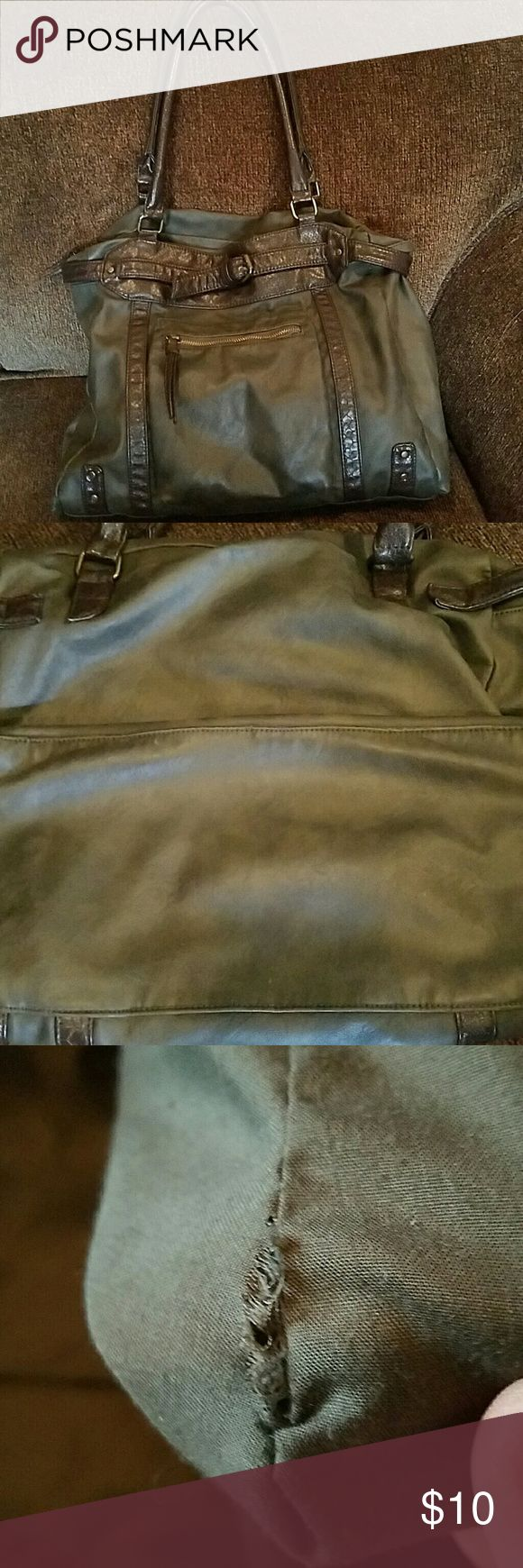 """Converse bag Army green color with dark brown trim Converse bag.  Distressed style, nice sized bag.  2nd pictures shows back side and bottom of the bag.  3rd show a very small area where the stitching came apart.  Easily fixed.  4th shows more of the bags liner.  Overall the bag is in very good shspe. Size 14"""" x 14"""" Converse Bags"""