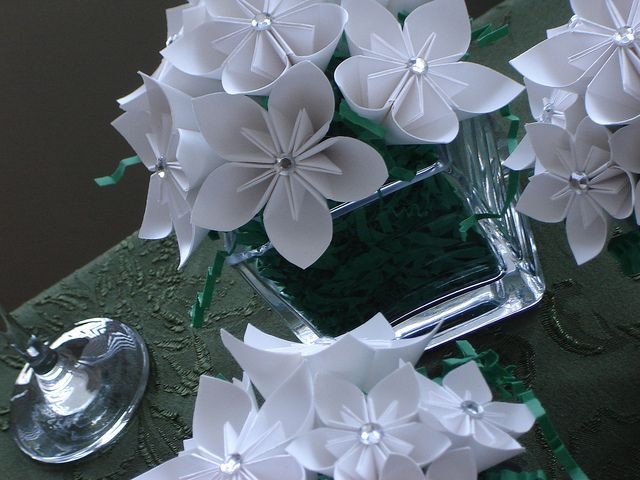 """instead of """"grass""""..use crushed bling in smallest vases? or use nothing and put bling band at top of vase"""