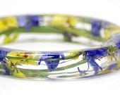 Clear resin flower bangles.