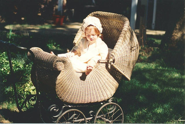 """My mom and I dressed my daughter Lauren up in old clothes and took pictures of her in this antique baby buggy that my mom owns. My daughter is now a teenager so this was taken awhile ago. She looking at her cute toes! Now she's 5'9"""" and taller than m"""