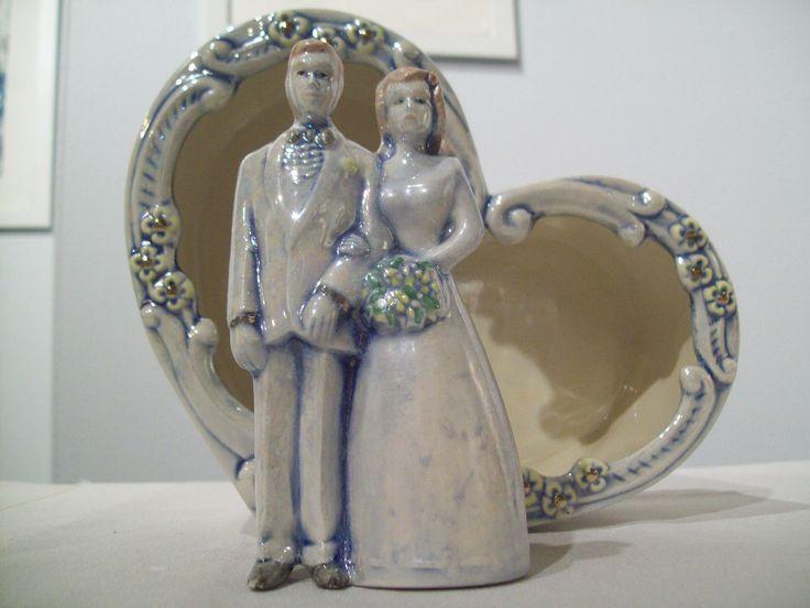 Ceramic wedding cake topper, hand made, personalized. $25.00, via Etsy.