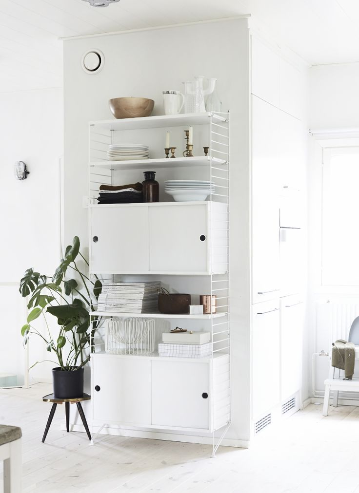 String wall shelf in white again.